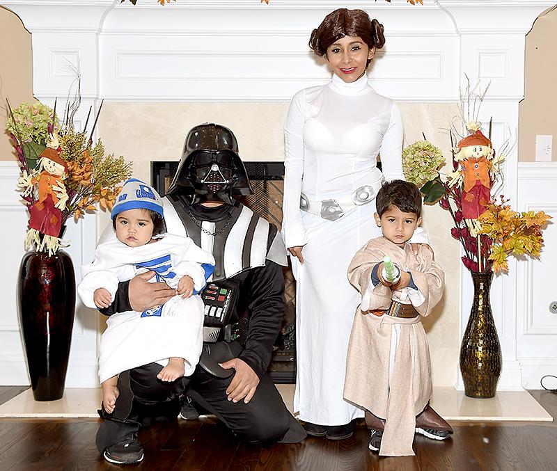 <p>More <i>Star Wars</i> fans! JWoww's fellow <i>Jersey Shore</i> pal showed off her fit body in a curve-hugging Princess Leia dress — with buns, of course. Her hubby was Darth Vader, her son was a lightsaber-swinging Jedi, and her daughter was the cutest little barefoot R2-D2 we have ever set our eyes on. (Photo: Jamie McCarthy/Getty Images) </p>