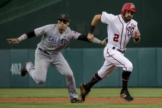 Washington Nationals' Adam Eaton (2) is tagged out by Chicago Cubs shortstop Javier Baez after trying to steal second during the third inning of a baseball game Saturday, May 18, 2019, in Washington. (AP Photo/Andrew Harnik)