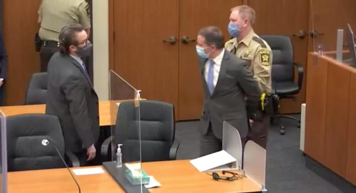 Derek Chauvin is led out of the courtroom in handcuffs April 20 after he was declared guilty in the death of George Floyd in Minneapolis.