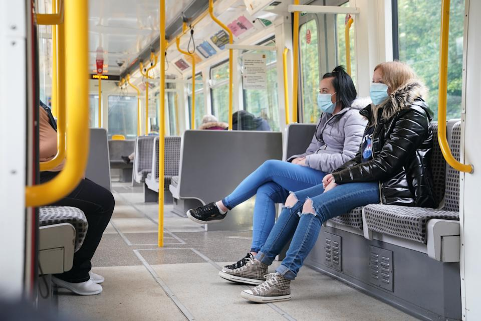 Passengers wearing face masks on a train in Newcastle as face coverings become mandatory on public transport in England with the easing of further lockdown restrictions during the coronavirus pandemic.