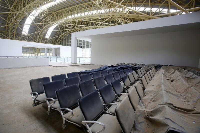 Dust covered seats are pictured inside the lounge of the Jaisalmer Airport in desert state of Rajasthan, India, August 13, 2015. REUTERS/Anindito Mukherjee
