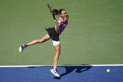 Petra Martic, of Croatia, returns a shot to Yulia Putintseva, of Kazakhstan, during the fourth round of the US Open tennis championships, Sunday, Sept. 6, 2020, in New York. (AP Photo/Seth Wenig)