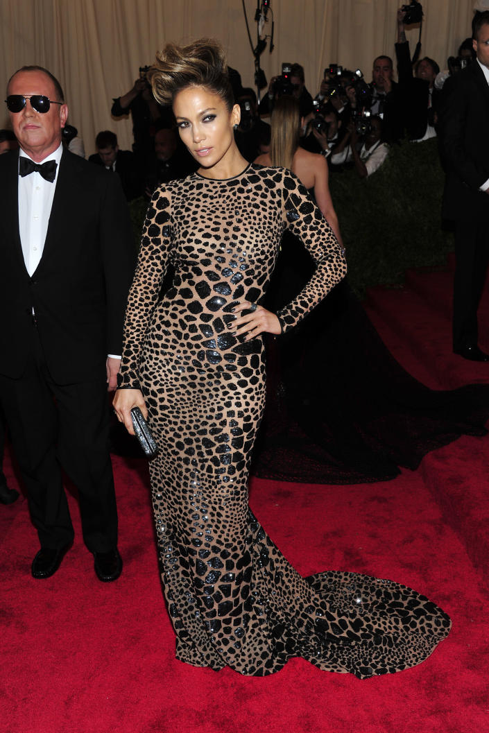 """Jennifer Lopez attends The Metropolitan Museum of Art's Costume Institute benefit celebrating """"PUNK: Chaos to Couture"""" on Monday May 6, 2013 in New York. Designer Michael Kors stands at left. (Photo by Charles Sykes/Invision/AP)"""