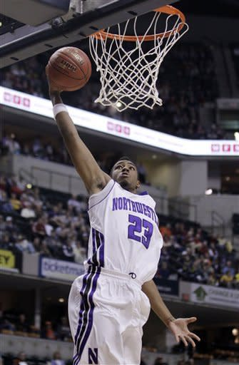 Northwestern guard JerShon Cobb (23) goes up for a layup in the first half of an NCAA college basketball game against Minnesota in the first round of the Big Ten Conference tournament in Indianapolis, Thursday, March 8, 2012. (AP Photo/Michael Conroy)