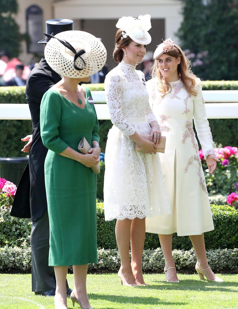 <p>Sophie also wore green – but a darker shade than Her Majesty. The Countess teamed her emerald midi dress with an on-trend rattan hat. <br><em>[Photo: Getty]</em> </p>