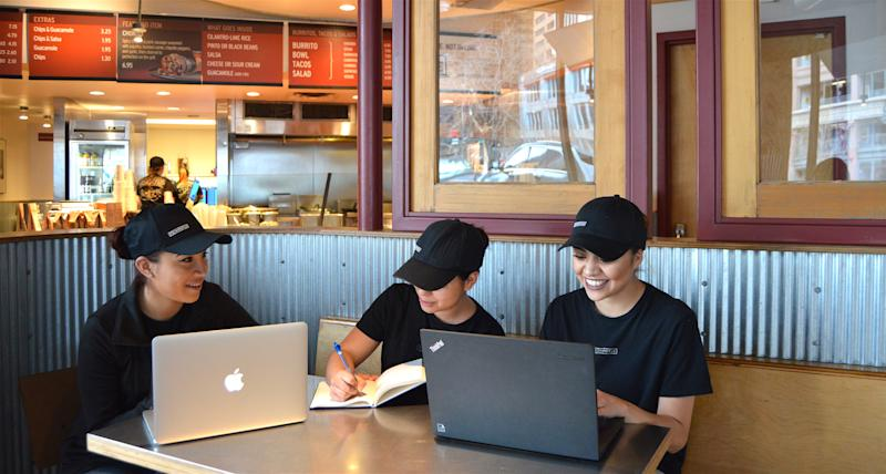 Chipotle employees working at a Chipotle.