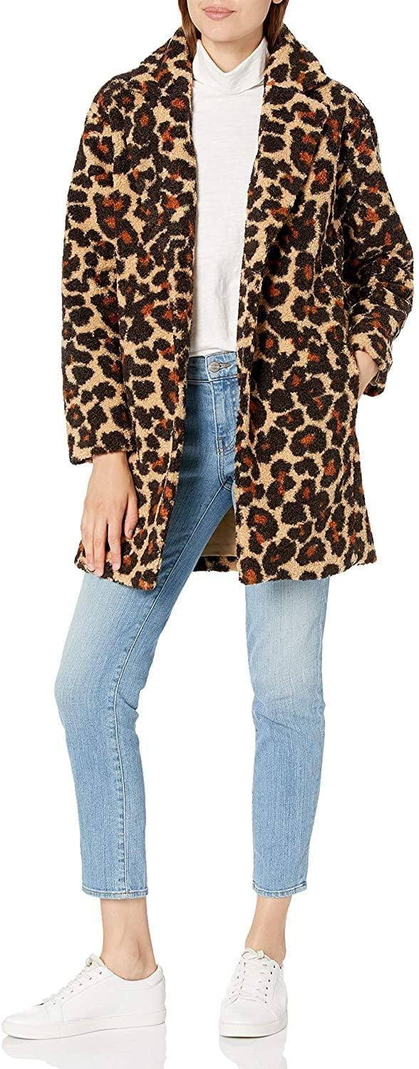 """<p>Made with a plush teddy-bear fleece, the <span>Daily Ritual Women's Lapel Coat</span> ($60) feels just as good as it looks. This jacket is available in a handful of punchy colors, but I'm seriously digging this leopard print. (After all, it makes a statement without going full-on <strong><a class=""""link rapid-noclick-resp"""" href=""""https://www.popsugar.co.uk/tag/Tiger-King"""" rel=""""nofollow noopener"""" target=""""_blank"""" data-ylk=""""slk:Tiger King"""">Tiger King</a></strong>.)</p>"""