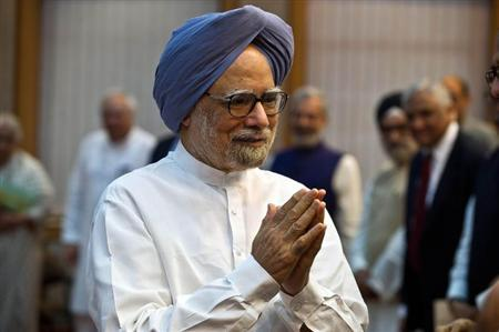 "Indian Prime Minister Manmohan Singh gestures as he arrives for the launch of the ""Gandhi Heritage Portal"" in New Delhi"