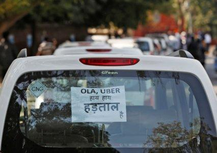 "FILE PHOTO: A note is pasted on a rear window of a car during a protest by Uber and Ola drivers, in New Delhi, India, February 14, 2017. The note reads ""Ola and Uber it is Strike"". REUTERS/Adnan Abidi"