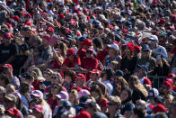 Supporters of President Donald Trump listen to him speak during a campaign rally at Laughlin/Bullhead International Airport, Wednesday, Oct. 28, 2020, in Bullhead City, Ariz. (AP Photo/Evan Vucci)