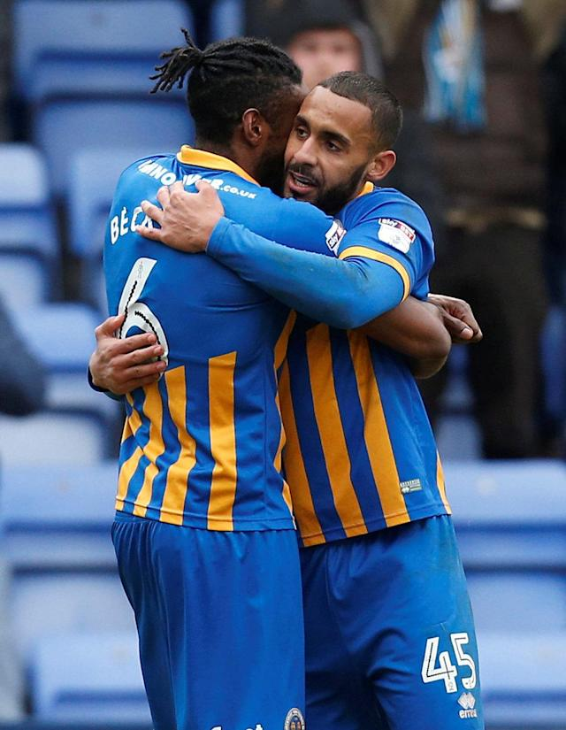 "Soccer Football - League One - Shrewsbury Town vs AFC Wimbledon - Montgomery Waters Meadow, Shrewsbury, Britain - March 24, 2018 Shrewsbury Town's Stefan Payne celebrates scoring their first goal with Omar Beckles Action Images/Ed Sykes EDITORIAL USE ONLY. No use with unauthorized audio, video, data, fixture lists, club/league logos or ""live"" services. Online in-match use limited to 75 images, no video emulation. No use in betting, games or single club/league/player publications. Please contact your account representative for further details."