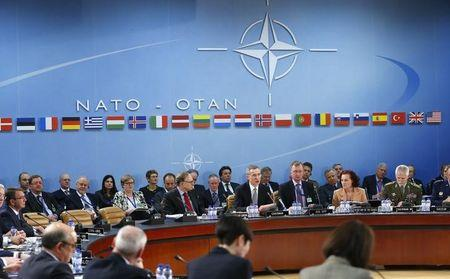 NATO Secretary General Jens Stoltenberg addresses a NATO defence ministers meeting at the Alliance's headquarters in Brussels