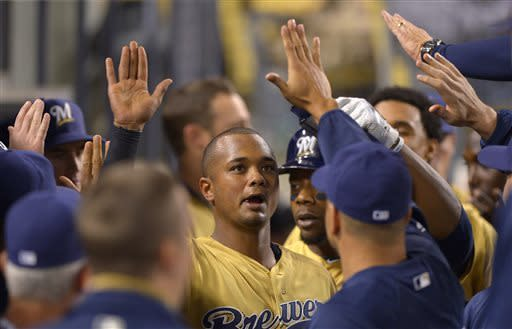 Milwaukee Brewers' Martin Maldonado is congratulated by teammates after hitting a two-run home run during the eighth inning of their baseball game against the Los Angeles Dodgers, Saturday, April 27, 2013, in Los Angeles. (AP Photo/Mark J. Terrill)
