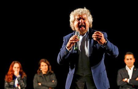 Beppe Grillo, the founder of the anti-establishment 5-Star Movement, talks during a march in support of the 'No' vote in the upcoming constitutional reform referendum in Rome