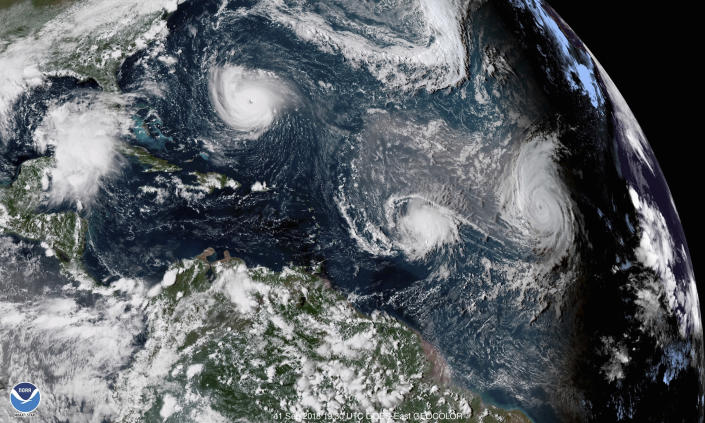 <p>This enhanced satellite image made available by NOAA shows Tropical Storm Florence, upper left, in the Atlantic Ocean on Tuesday, Sept. 11, 2018 at 3:30 p.m. EDT. At center is Tropical Storm Isaac and at right is Hurricane Helene. (Photo: NOAA via AP) </p>