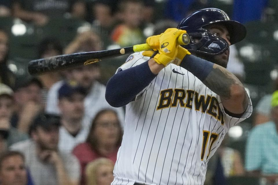 Milwaukee Brewers' Omar Narvaez hits an RBI single during the third inning of a baseball game against the Pittsburgh Pirates Saturday, June 12, 2021, in Milwaukee. (AP Photo/Morry Gash)