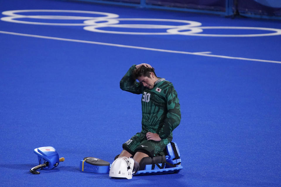 Japan goalkeeper Takashi Yoshikawa (30) reacts after Japan lost to Spain in a men's field hockey match at the 2020 Summer Olympics, Wednesday, July 28, 2021, in Tokyo, Japan. (AP Photo/John Locher)