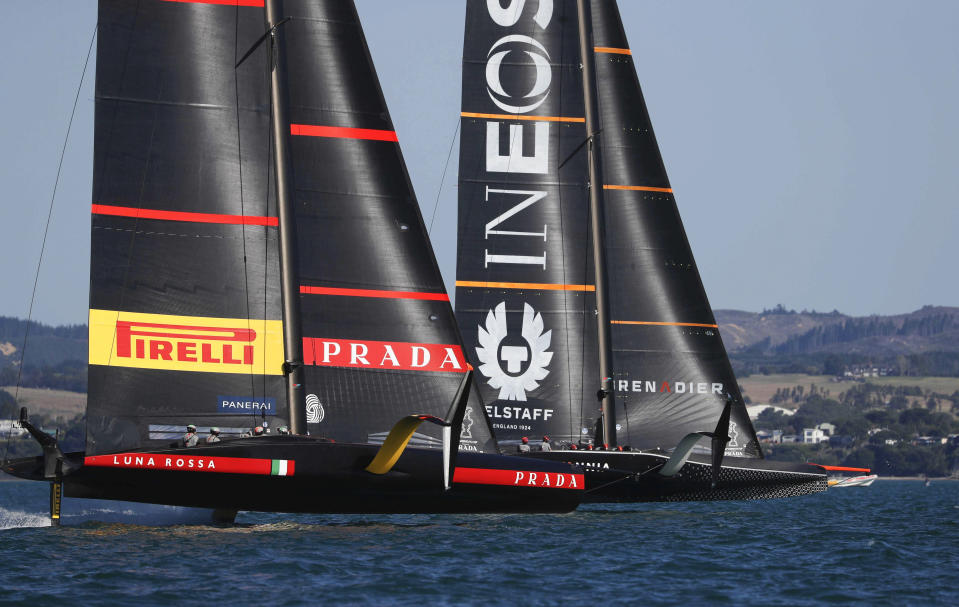 Britain's INEOS Team UK, right, leads Italy's Luna Rossa to win race six of the Prada Cup on Auckland's Waitemata Harbour, New Zealand, Saturday, Feb. 20, 2021. (Dean Purcell/NZ Herald via AP)