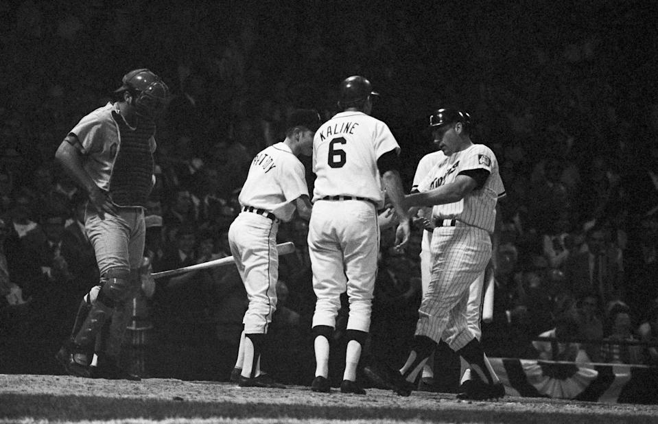 American League first baseman Harmon Killebrew, right, crosses home plate after his home run in the sixth inning in the All-Star Game on July 13, 1971 at Tiger Stadium in Detroit. Tigers' Al Kaline (6) was on base with a single when Killebrew's home run landed in the left-field seats. The hit produced the winning run as the AL won 6-4.