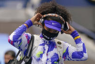 Naomi Osaka, of Japan, pulls off her headphones as she walks on the court before playing against Victoria Azarenka, of Belarus, in the women's singles final of the US Open tennis championships, Saturday, Sept. 12, 2020, in New York. (AP Photo/Seth Wenig)