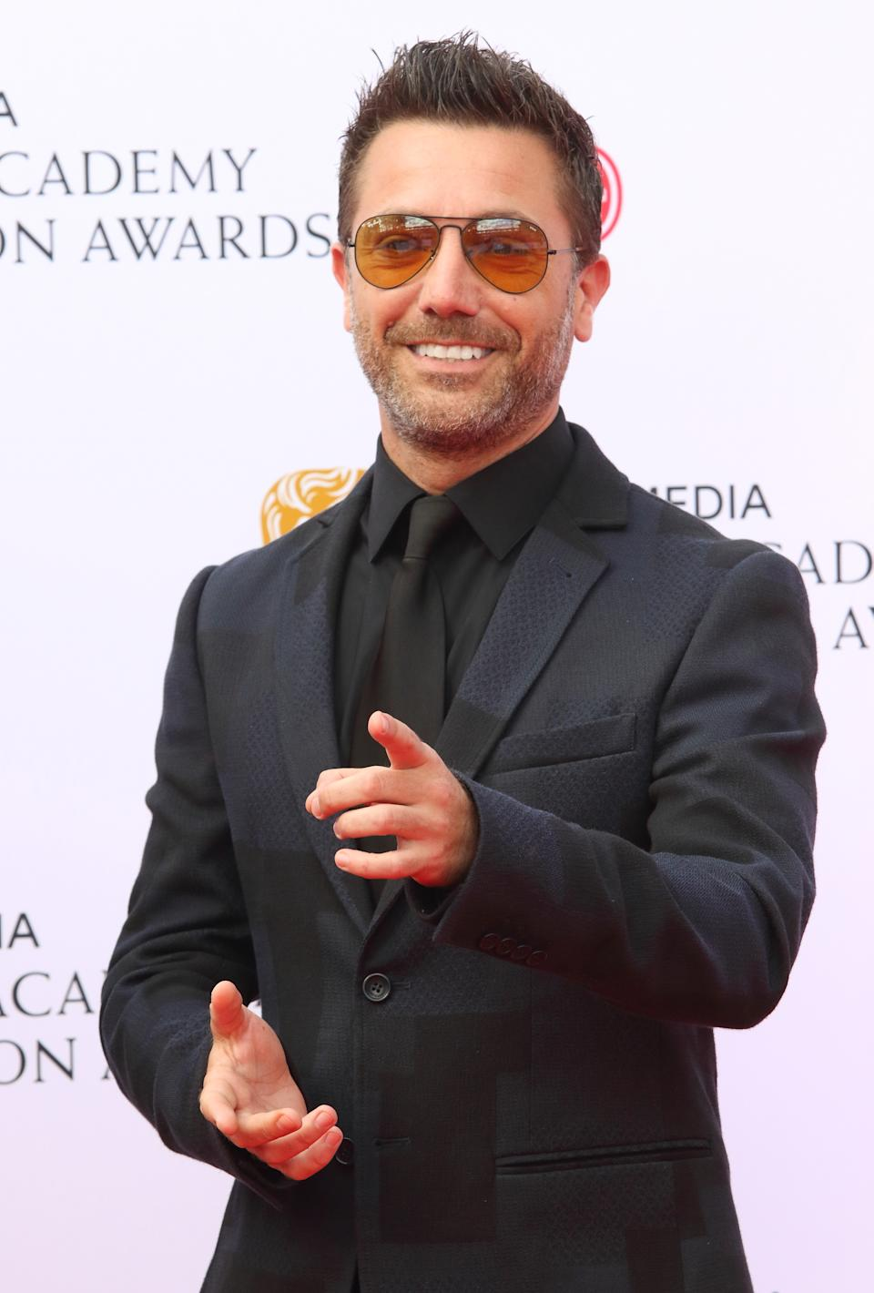 Gino D'Acampo seen on the red carpet during the Virgin Media BAFTA Television Awards 2019 at The Royal Festival Hall in London. (Photo by Keith Mayhew / SOPA Images/Sipa USA)