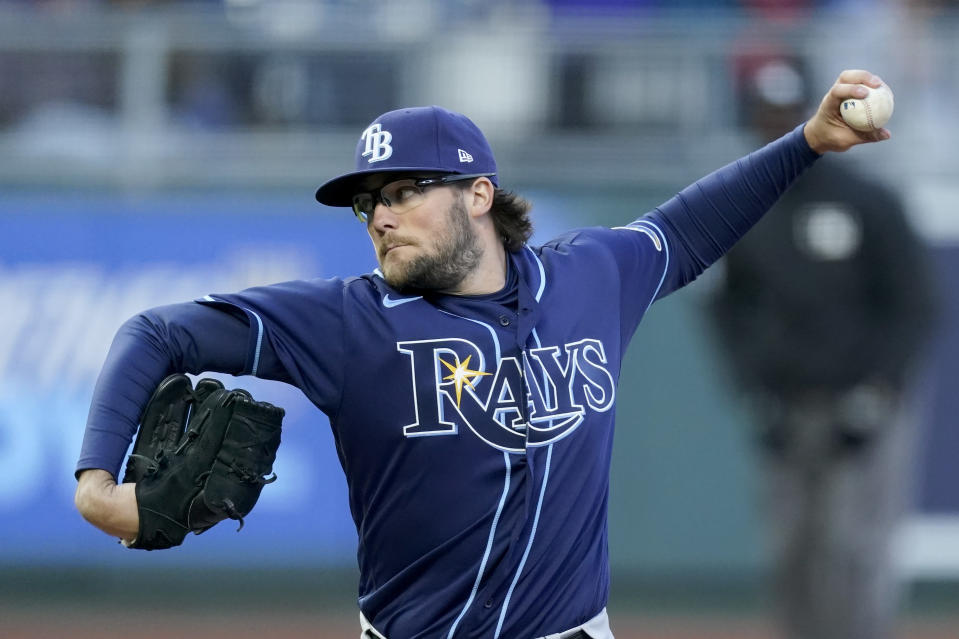 Tampa Bay Rays starting pitcher Josh Fleming throws during the first inning of a baseball game against the Kansas City Royals, Monday, April 19, 2021, in Kansas City, Mo. (AP Photo/Charlie Riedel)