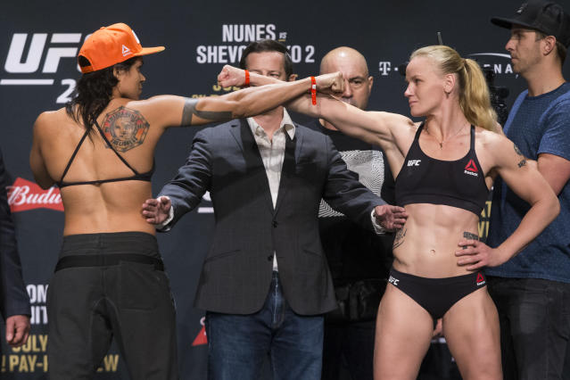 Amanda Nunes, left, and Valentina Shevchenko pose during the UFC 213 ceremonial weigh-in. (AP)