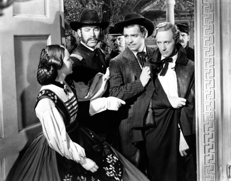 Actors Olivia De Havilland, Clark Gable and Leslie Howard, as Melanie Hamilton, Rhett Butler and Ashley Wilkes respectively in Gone with the Wind by Victor Fleming, in a scene from the movie. USA, 1939. (Photo by Mondadori via Getty Images)