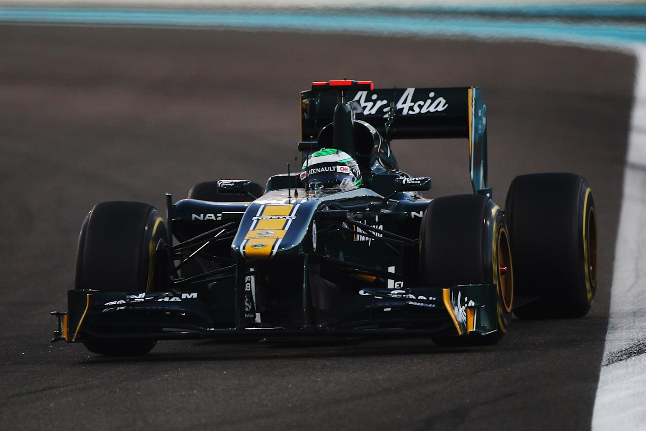 ABU DHABI, UNITED ARAB EMIRATES - NOVEMBER 13:  Heikki Kovalainen of Finland and Team Lotus drives during the Abu Dhabi Formula One Grand Prix at the Yas Marina Circuit on November 13, 2011 in Abu Dhabi, United Arab Emirates.  (Photo by Clive Mason/Getty Images)