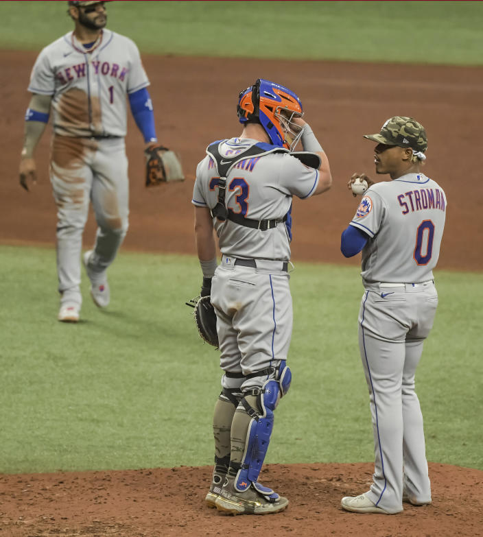 New York Mets catcher James McCann (33) talks with Marcus Stroman (0) after giving up a two-run home run to Tampa Bay Rays' Willy Adames during the fifth inning of a baseball game Sunday, May 16, 2021, in St. Petersburg, Fla. (AP Photo/Steve Nesius)