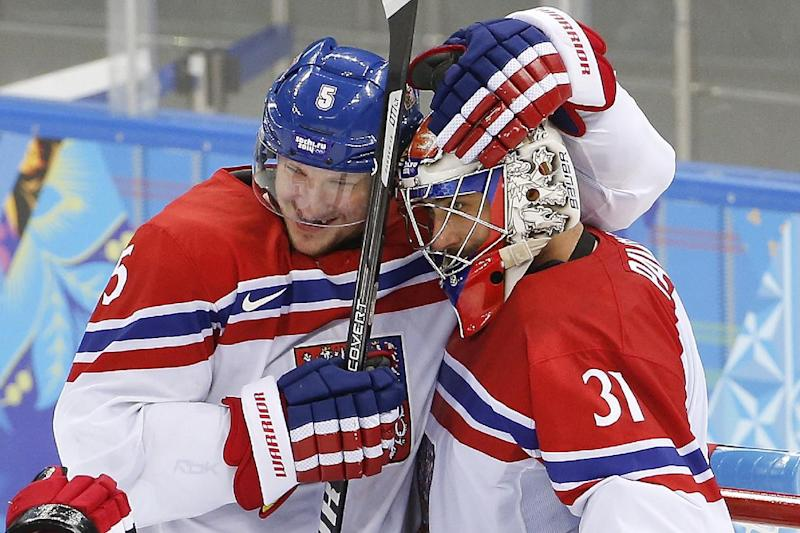 Czech Republic defenseman Ladislav Smid celebrates their 5-3 win over Slovakia with goaltender Ondrej Pavelec, right, after the 2014 Winter Olympics men's ice hockey game at Shayba Arena, Tuesday, Feb. 18, 2014, in Sochi, Russia. (AP Photo/Petr David Josek)
