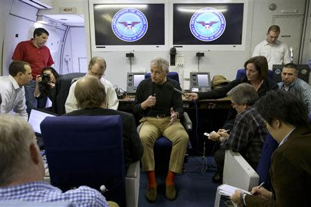 U.S. Defense Secretary Chuck Hagel speaks to the travelling press aboard a U.S. military aircraft en route to Seoul, South Korea September 28, 2013. REUTERS/Jacquelyn Martin/Pool