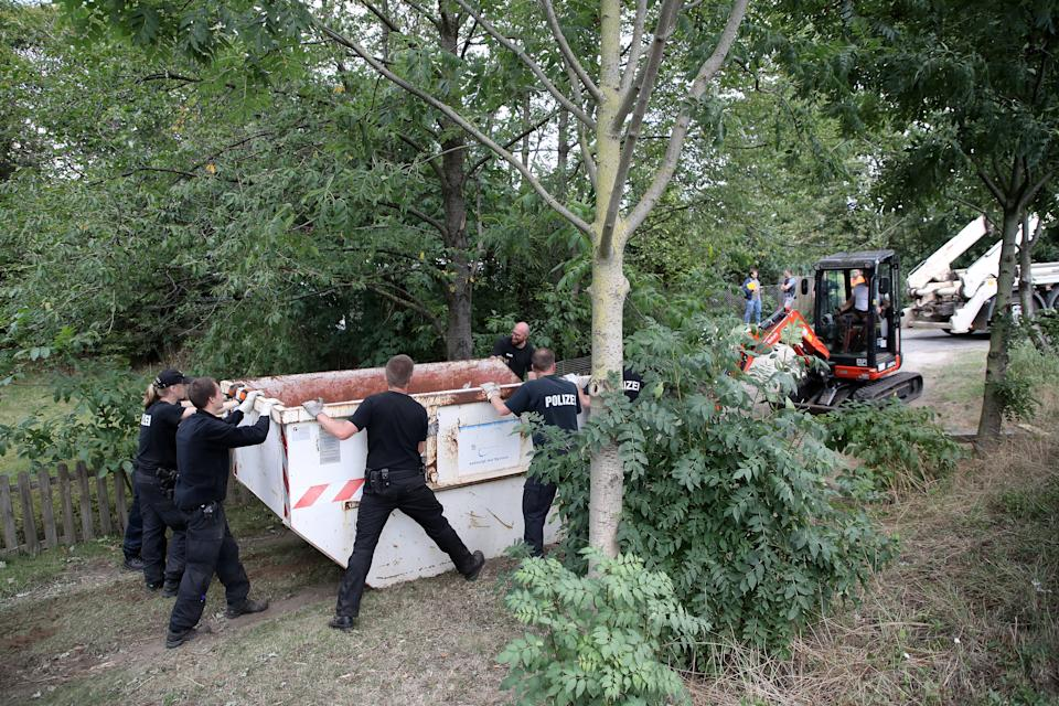 Police officers dig and search a garden plot in Hannover, northern Germany. Police is working on the site in relation to the investigation of the Madeleine 'Maddie' McCann case.