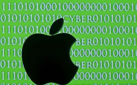 3D printed Apple logo are seen in front of a displayed cyber code in this illustration taken February 26, 2016. REUTERS/Dado Ruvic/Illustration