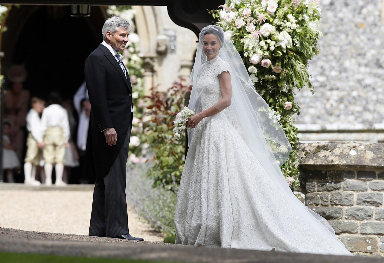 "<p>The bride arrived to the church looking gorgeous in a <a rel=""nofollow"" href=""https://www.yahoo.com/style/pippa-middleton-marries-james-matthews-lace-giles-deacon-gown-113157258.html"">bespoke lace gown</a> by British designer Giles Deacon. She completed her floor-sweeping look with a veil by milliner Stephen Jones. (Photo: PA) </p>"