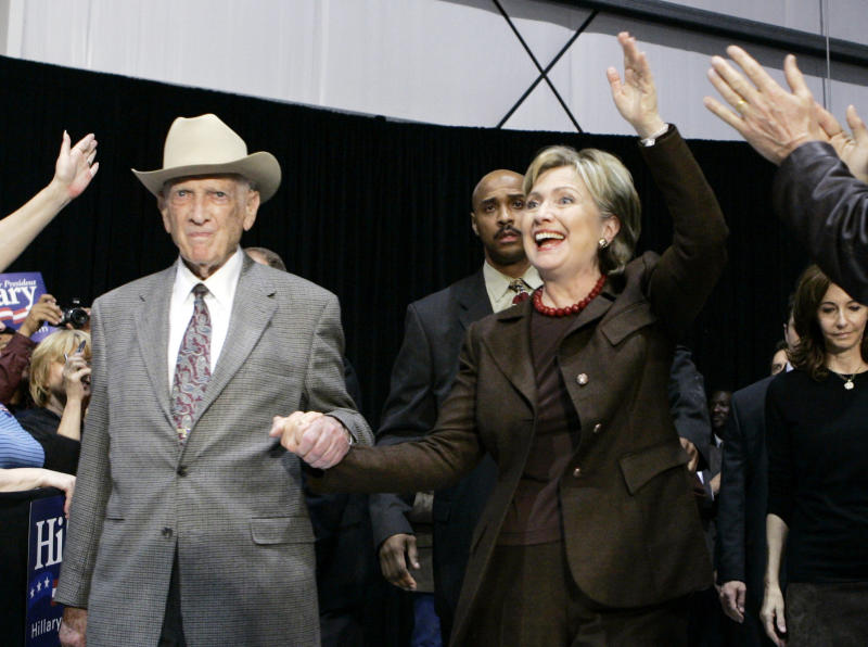 FILE - In this March 3, 2008, file photo, former U.S. Rep Jack Brooks escorts Hillary Rodham Clinton to the stage during a campaign stop at the Beaumont, Texas, Airport. Brooks, a Democrat who spent 42 years representing his Southeast Texas district, has died at age 89. (AP Photo/Carolyn Kaster, File)