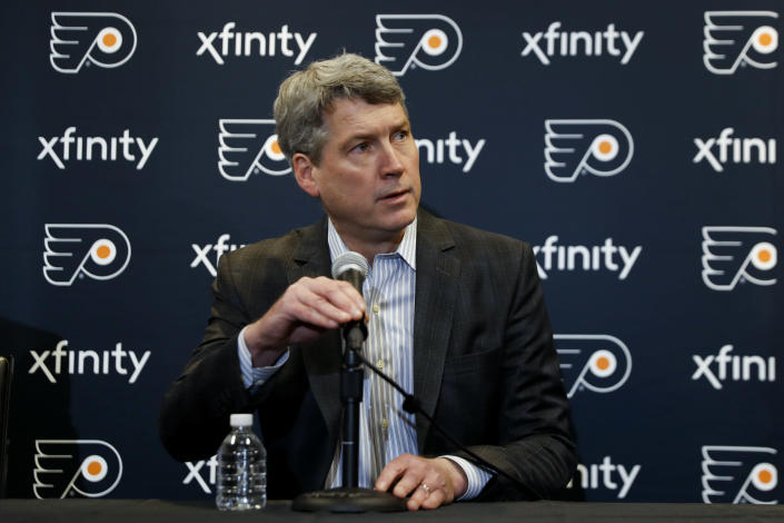 FILE - Philadelphia Flyers general manager Chuck Fletcher speaks to the media during an introductory press conference for head coach Alain Vigneault at the Flyer's practice facility in Voorhees, N.J., in this Thursday, April 18, 2019, file photo. The Flyers were a mess last season and general manager Chuck Fletcher knew it. He's traded five players and three draft picks in the last week and is trying to make them contenders again in the East. (AP Photo/Matt Slocum, File)