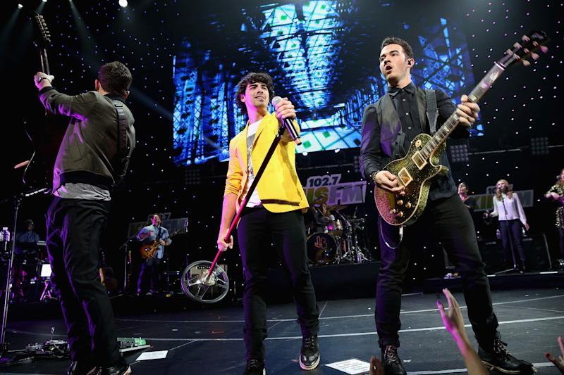 LOS ANGELES, CA - DECEMBER 01: (L-R) Musicians Nick Jonas, Joe Jonas, and Kevin Jonas of The Jonas Brothers perform onstage during KIIS FM's 2012 Jingle Ball at Nokia Theatre L.A. Live on December 1, 2012 in Los Angeles, California. (Photo by Christopher Polk/Getty Images for Clear Channel)