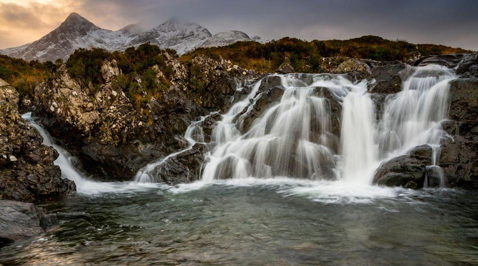 <p>Clouds graze the top of the Cuillin mountains as water flows into a nearby outlet in the Isle of Skye, Scotland // December 12, 2015</p>