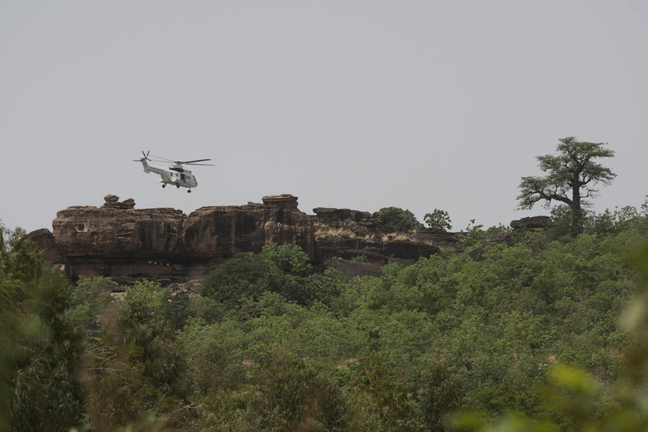 <p>A UN helicopter searches for survivers in the area of Kangaba tourist resort near Bamako on June 19, 2017 after suspected jihadists stormed the resort on June 18, briefly seizing more than 30 hostages and leaving at least two people dead. (Michele Cattani/AFP/Getty Images) </p>