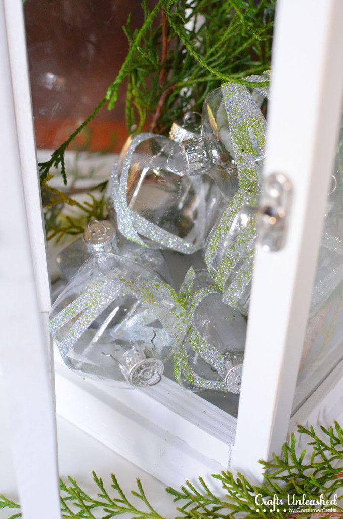"""<p>Whether you heap these gorgeous, glitter-striped cube ornaments together in a pretty pile or hang them on your tree, they're sure to become some of your favorite decorations.</p><p><strong>Get the tutorial at <a href=""""http://blog.consumercrafts.com/seasonal/winter/glittered-clear-glass-ornaments/"""" rel=""""nofollow noopener"""" target=""""_blank"""" data-ylk=""""slk:Crafts Unleashed"""" class=""""link rapid-noclick-resp"""">Crafts Unleashed</a>.</strong></p><p><a class=""""link rapid-noclick-resp"""" href=""""https://www.amazon.com/Double-Sided-Tape-Craft/s?k=Double-Sided+Tape+for+Craft&tag=syn-yahoo-20&ascsubtag=%5Bartid%7C10050.g.28831556%5Bsrc%7Cyahoo-us"""" rel=""""nofollow noopener"""" target=""""_blank"""" data-ylk=""""slk:SHOP DOUBLE-SIDED TAPE"""">SHOP DOUBLE-SIDED TAPE</a><br></p>"""