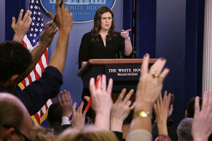 Look at all the reporters' hands in the air.Why can't they get factually correct answers? (Photo: Chip Somodevilla via Getty Images)