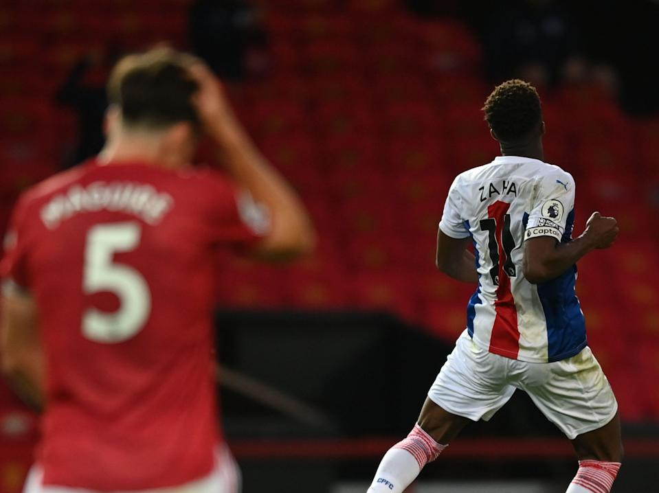 Wilfried Zaha celebrates scoring against his former side Manchester United (POOL/AFP via Getty Images)