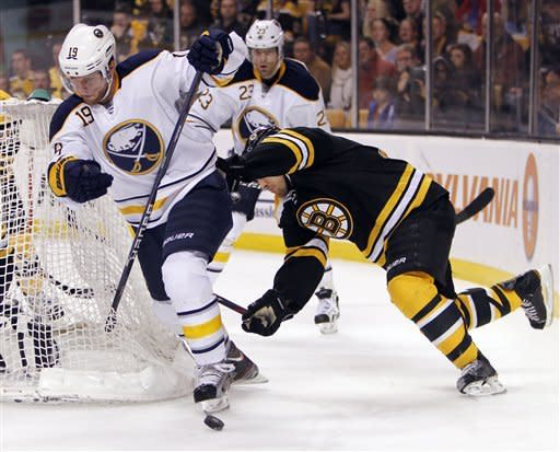 Buffalo Sabres' Cody Hodgson (19) comes around the net as Boston Bruins' Andrew Ference, right, defends in the first period of an NHL hockey game in Boston, April 7, 2012. (AP Photo/Michael Dwyer)