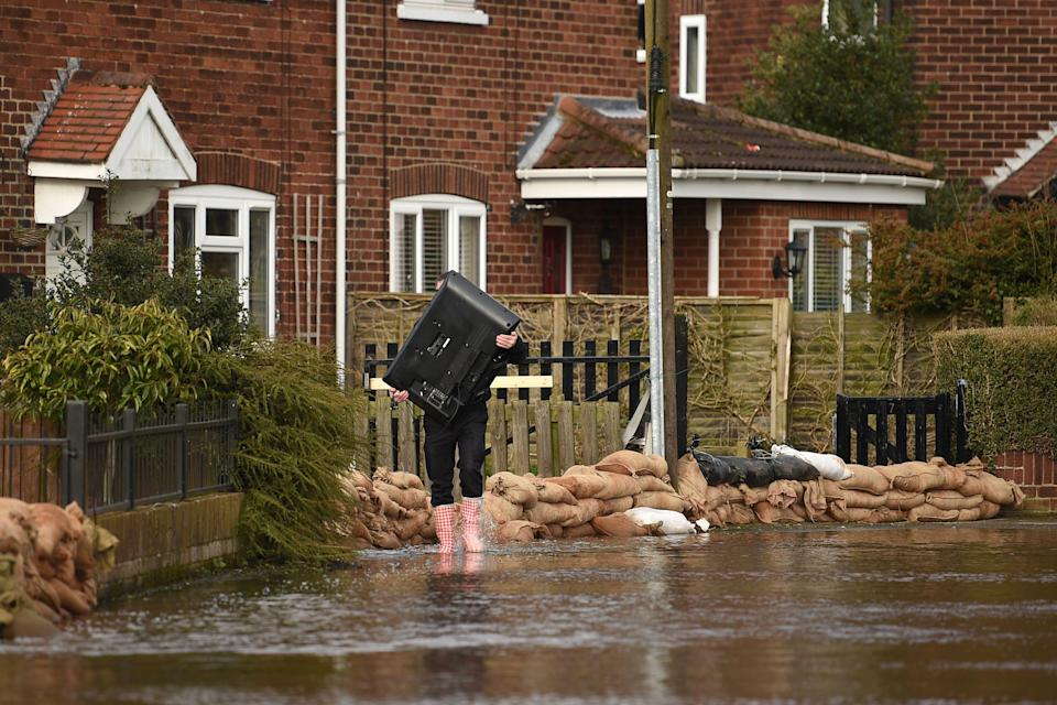 <p>Over the last decade, more than 120,000 new homes in England and Wales were built in flood-prone areas, according to the researchers</p> (AFP/Getty)