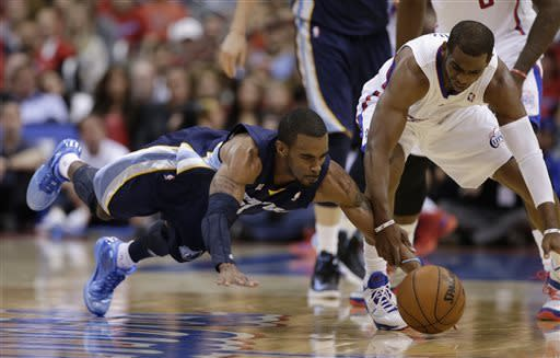 Memphis Grizzlies guard Mike Conley, left, dives for a loose ball along with Los Angeles Clippers guard Chris Paul during the second half of Game 1 of a first-round NBA basketball playoff series Los Angeles, Saturday, April 20, 2013. (AP Photo/Chris Carlson)