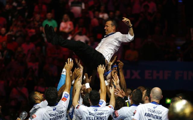 Handball - Men's EHF Champions League Final - HBC Nantes vs Montpellier HB - Lanxess Arena, Cologne, Germany - May 27, 2018. Montpellier HB players throw coach Patrice Canayer in the air as they celebrate winning the match. REUTERS/Thilo Schmuelgen