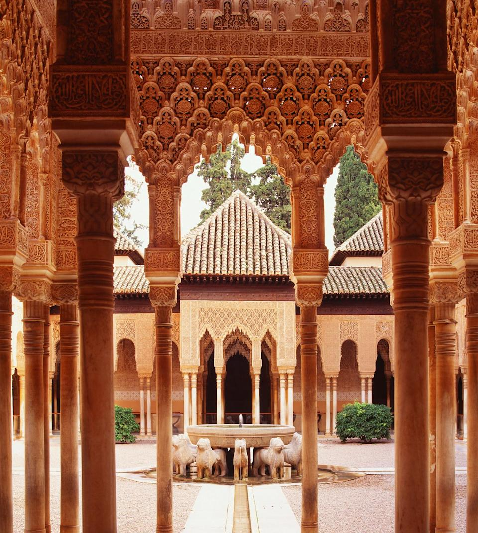 A courtyard framed with carvings in the Alhambra.