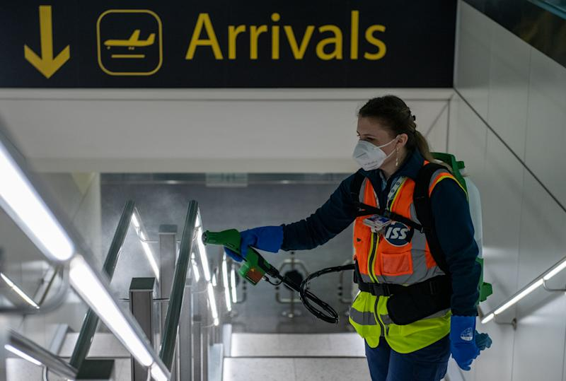 LONDON, ENGLAND - JUNE 09: Cleaners spray a peroxide based disinfectant on handrails and surfaces as a protective measure against the spread of the coronavirus (COVID-19) inside the currently closed North Terminal at Gatwick Airport on June 9, 2020 in London, England. Gatwick Airport has introduced a range of protective measures to battle the spread of the coronavirus (COVID-19) as the airport prepares to increase operating hours from June 15, 2020, and to resume operations at the North Terminal with a range of airlines. The airport's North Terminal closed in March due to the impact that coronavirus outbreak had on the number of flights able to operate. (Photo by Chris J Ratcliffe/Getty Images)