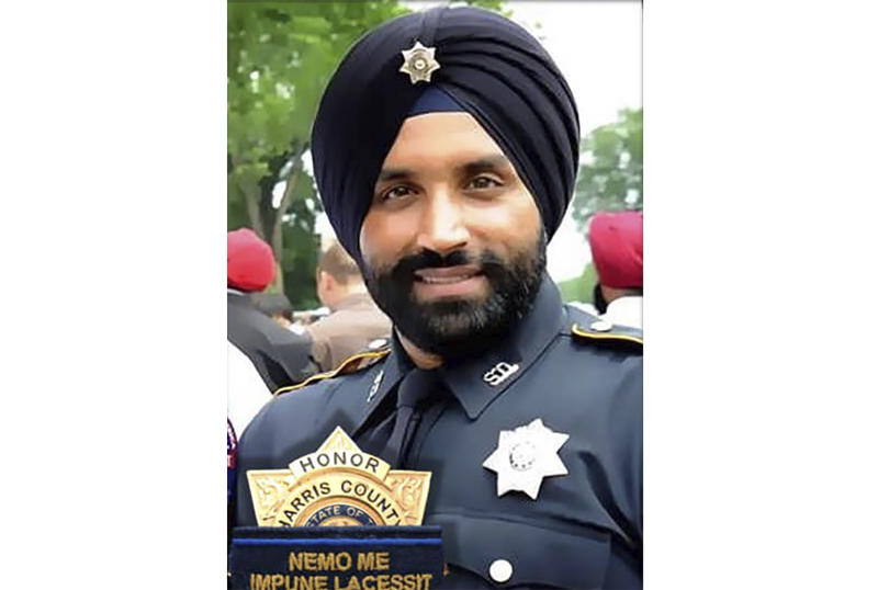 This photo provided by Harris County Sheriff's office shows Deputy Sandeep Dhaliwal. Dhaliwal was shot and killed while making a traffic stop Friday, Sept. 27, 2019 near Houston. Robert Solis, 47, of Houston, was charged Friday night with capital murder in the slaying. He was being held without bond in the Harris County Jail.  (Harris County Sheriff's office via AP)